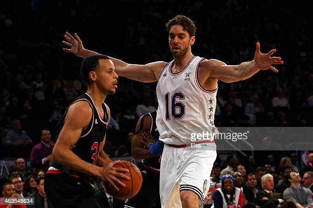 Stephen Curry of the Golden State Warriors and the Western Conference looks to pass against Pau Gasol of the Chicago Bulls and the Eastern Conference...