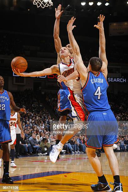 Stephen Curry of the Golden State Warriors attempts a circus shot against Nick Collison of the Oklahoma City Thunder on February 6 2010 at Oracle...