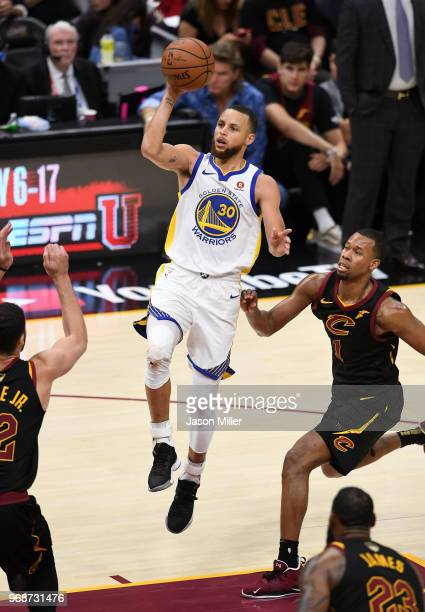 Stephen Curry of the Golden State Warriors attempts a layup against the Cleveland Cavaliers in the second half during Game Three of the 2018 NBA...