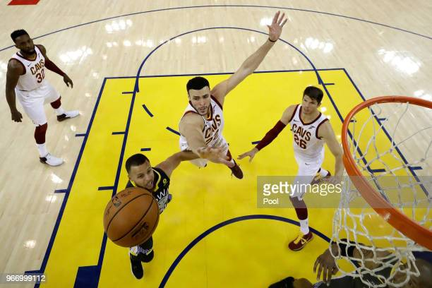 e97726387 Stephen Curry of the Golden State Warriors attempts a layup over Larry  Nance Jr  22