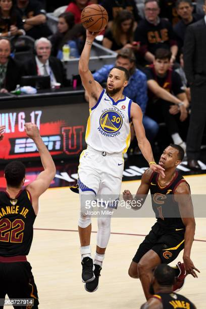 Stephen Curry of the Golden State Warriors attempts a layup over Larry Nance Jr #22 of the Cleveland Cavaliers in the second half during Game Three...