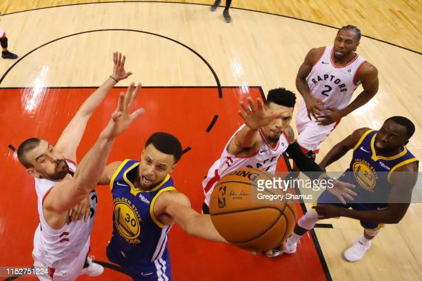 Stephen Curry of the Golden State Warriors attempts a shot against Marc Gasol of the Toronto Raptors in the second half during Game One of the 2019...