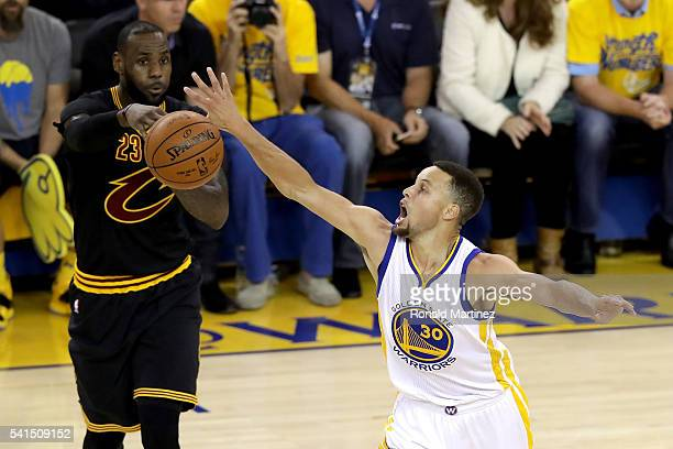 Stephen Curry of the Golden State Warriors attempts a steal against LeBron James of the Cleveland Cavaliers in Game 7 of the 2016 NBA Finals at...