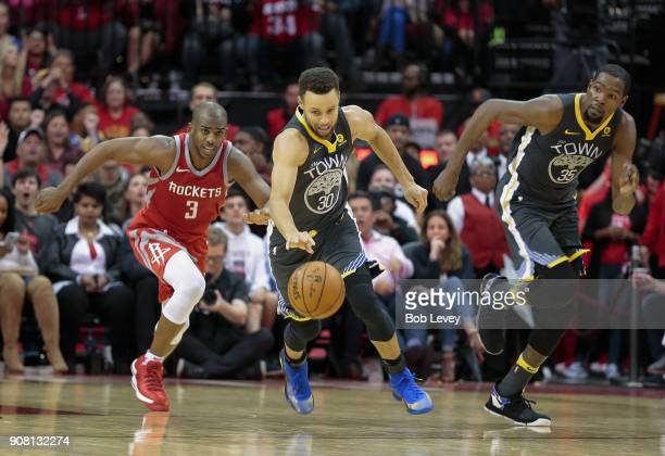 Stephen Curry of the Golden State Warriors breaks down court as Chris Paul of the Houston Rockets and Kevin Durant pursue at Toyota Center on January...