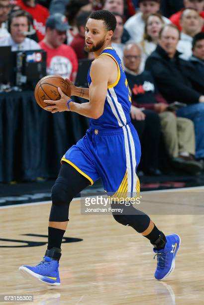 Stephen Curry of the Golden State Warriors bribbles the ball against the Portland Trail Blazers during Game Four of the Western Conference...