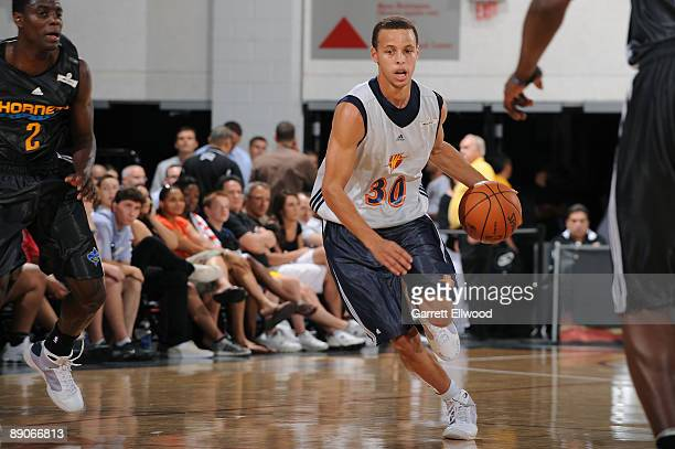 Stephen Curry of the Golden State Warriors brings the ball up court against the New Orleans Hornets during NBA Summer League presented by EA Sports...