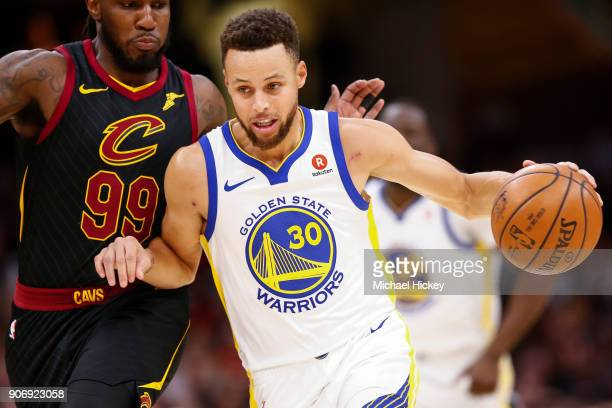Stephen Curry of the Golden State Warriors brings the ball up court during the game against the Cleveland Cavaliers at Quicken Loans Arena on January...