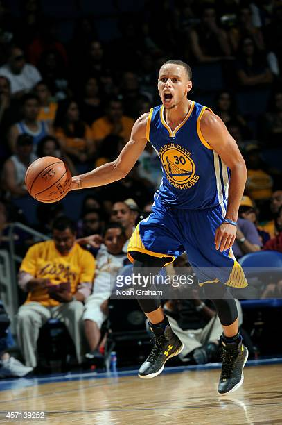 Stephen Curry of the Golden State Warriors brings the ball up the court during the game against the Los Angeles Lakers on October 12 2014 at Citizens...