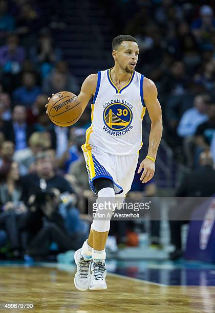 Stephen Curry of the Golden State Warriors brings the ball up the court during first half action against the Charlotte Hornets at Time Warner Cable...