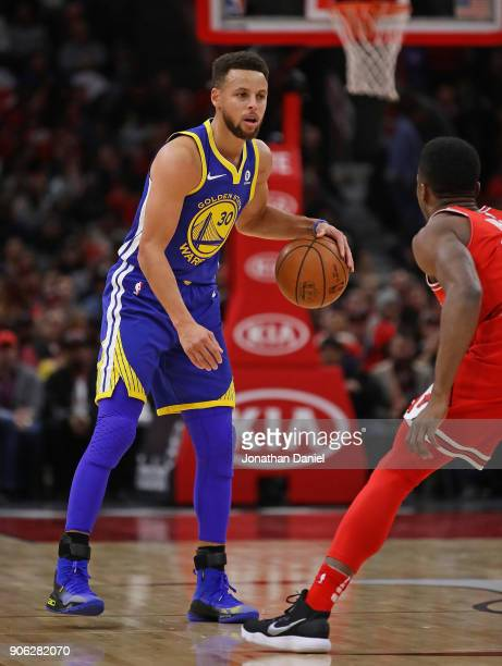 Stephen Curry of the Golden State Warriors brings the ball up the court against David Nwaba of the Chicago Bulls at the United Center on January 17...