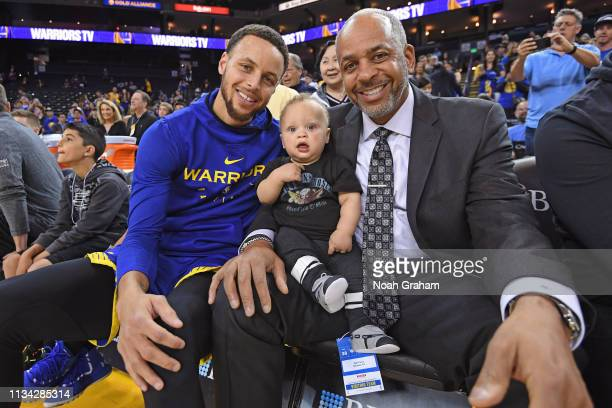 Stephen Curry of the Golden State Warriors Canon Jack Curry and Dell Curry pose for a photo before the game against the Charlotte Hornets on March 31...