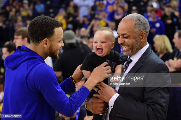 Stephen Curry of the Golden State Warriors Canon Jack Curry and Dell Curry talk before the game against the Charlotte Hornets on March 31 2019 at...