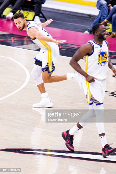 Stephen Curry of the Golden State Warriors celebrates a three point basket during the fourth quarter of a game against the Cleveland Cavaliers at...