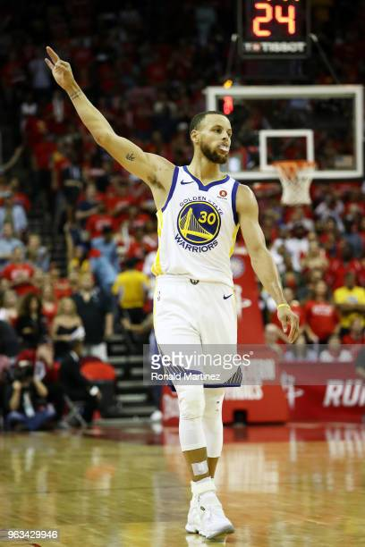 Stephen Curry of the Golden State Warriors celebrates a three pointer in the third quarter of Game Seven of the Western Conference Finals of the 2018...