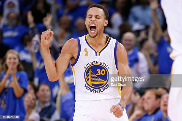 Stephen Curry of the Golden State Warriors celebrates after a three point basket against the New Orleans Pelicans during the NBA season opener at...