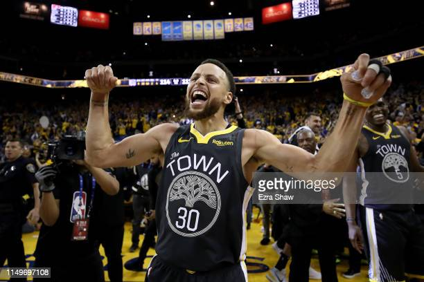 Stephen Curry of the Golden State Warriors celebrates after defeating the Portland Trail Blazers 114111 in game two of the NBA Western Conference...