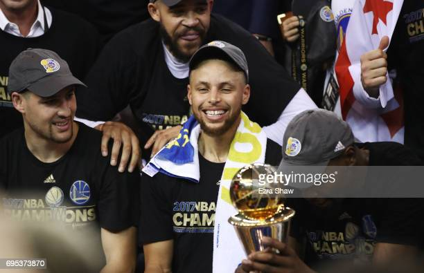 Stephen Curry of the Golden State Warriors celebrates after defeating the Cleveland Cavaliers 129120 in Game 5 to win the 2017 NBA Finals at ORACLE...
