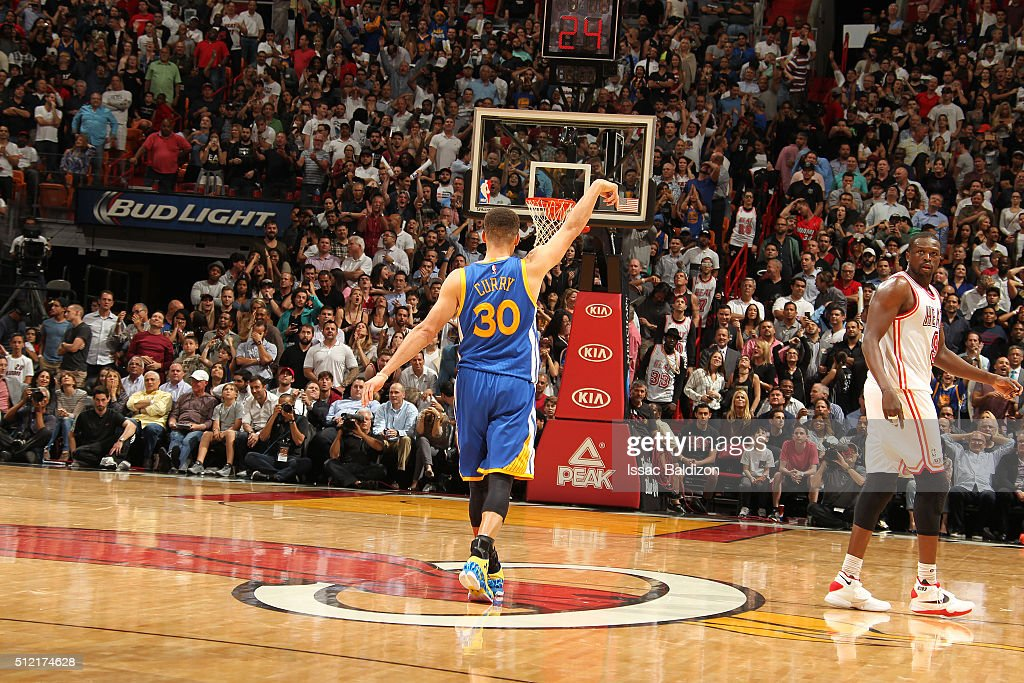 Stephen Curry #30 of the Golden State Warriors celebrates after hitting a three pointer during the game against the Miami Heat on February 24, 2016 at American Airlines Arena in Miami, Florida.