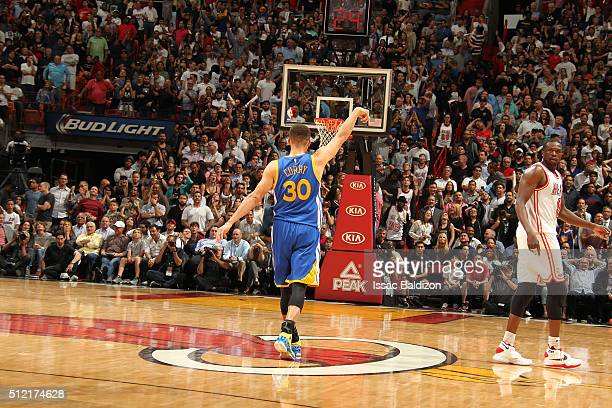 Stephen Curry of the Golden State Warriors celebrates after hitting a three pointer during the game against the Miami Heat on February 24 2016 at...