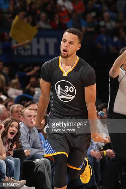 Stephen Curry of the Golden State Warriors celebrates after hitting a three point shot against the Oklahoma City Thunder on February 27 2016 at the...