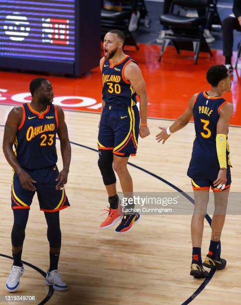 Stephen Curry of the Golden State Warriors celebrates after making a three-point basket in the first quarter of the NBA Play-In Tournament game...