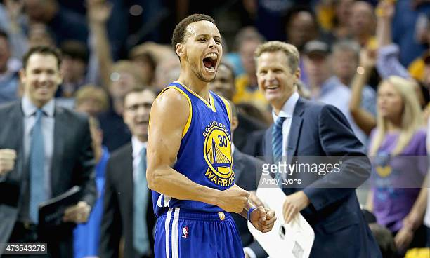 Stephen Curry of the Golden State Warriors celebrates after making a basket to end the third quarter against the Memphis Grizzlies during Game six of...