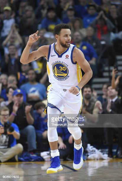Stephen Curry of the Golden State Warriors celebrates after making a threepoint shot against the Denver Nuggets during an NBA Basketballl game at...