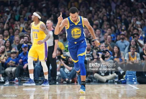 Stephen Curry of the Golden State Warriors celebrates after scoring a threepoint basket against the Los Angeles Lakers during the first half of their...