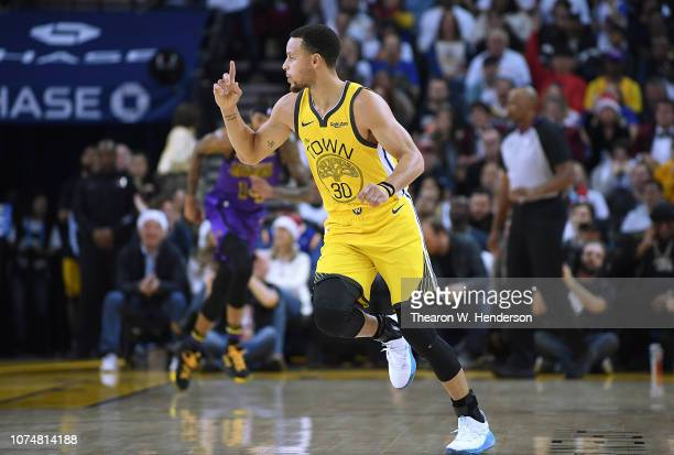 Stephen Curry of the Golden State Warriors celebrates after scoring over LeBron James of the Los Angeles Lakers during the first half of their NBA...
