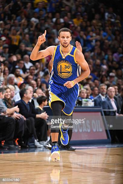 Stephen Curry of the Golden State Warriors celebrates after scoring against the Denver Nuggets on November 10 2016 at the Pepsi Center in Denver...