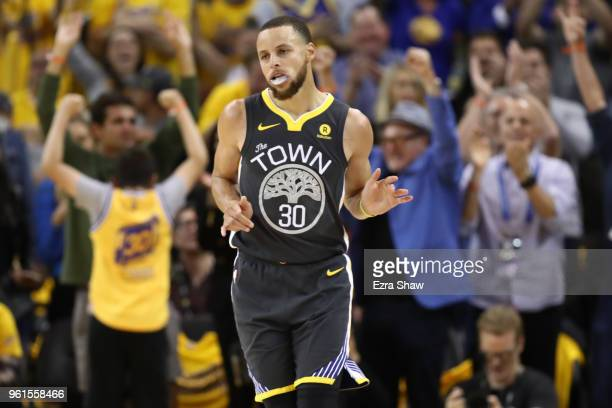 Stephen Curry of the Golden State Warriors celebrates after scoring against the Houston Rockets during Game Four of the Western Conference Finals of...