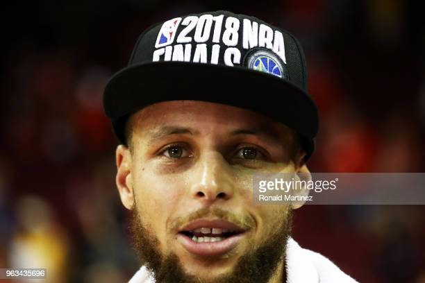 Stephen Curry of the Golden State Warriors celebrates after they defeated the Houston Rockets 101 to 92 in Game Seven of the Western Conference...