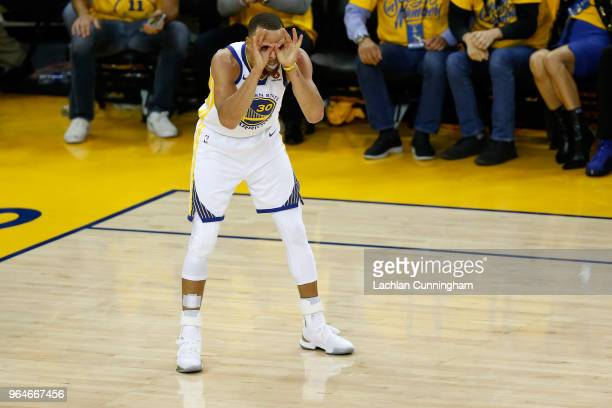 Stephen Curry of the Golden State Warriors celebrates against the Cleveland Cavaliers in overtime during Game 1 of the 2018 NBA Finals at ORACLE...