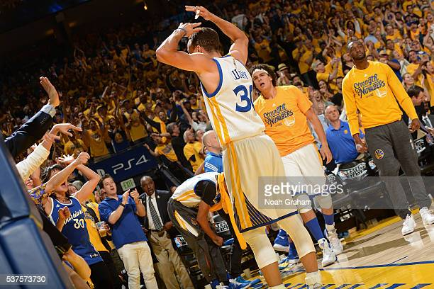 Stephen Curry of the Golden State Warriors celebrates and gets the crowd into the game against the Oklahoma City Thunder during Game Five of the...