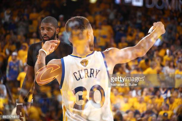 Stephen Curry of the Golden State Warriors celebrates and Kyrie Irving of the Cleveland Cavaliers looks on in Game Two of the 2017 NBA Finals on June...