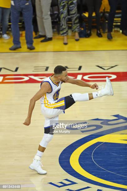 Stephen Curry of the Golden State Warriors celebrates and reacts to a three point basket in Game One of the 2017 NBA Finals against the Cleveland...