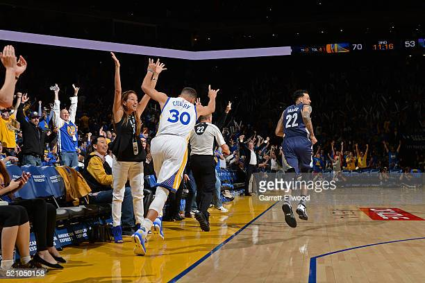Stephen Curry of the Golden State Warriors celebrates as he runs up court after hitting his 400th three point basket of the season during the game...