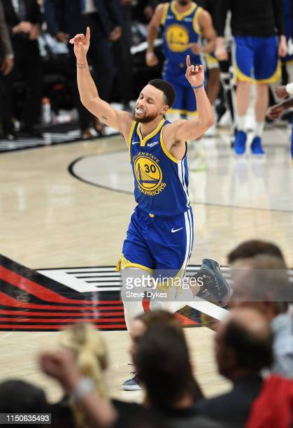 Stephen Curry of the Golden State Warriors celebrates defeating the Portland Trail Blazers 119-117 during overtime in game four of the NBA Western...