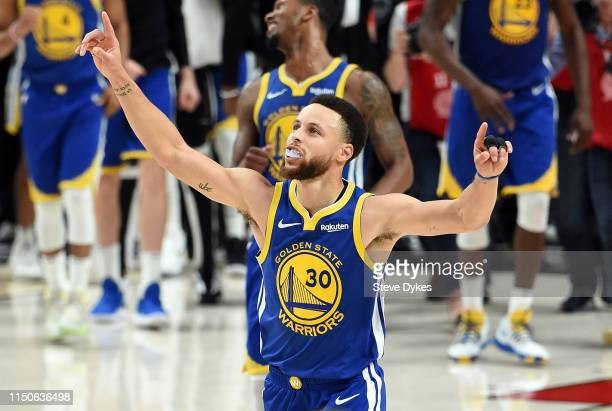 Stephen Curry of the Golden State Warriors celebrates defeating the Portland Trail Blazers 119117 during overtime in game four of the NBA Western...