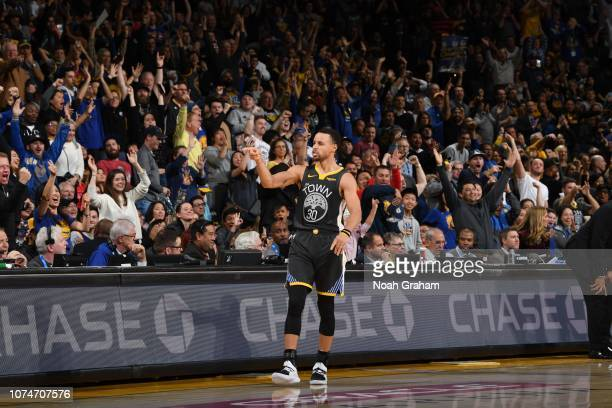 Stephen Curry of the Golden State Warriors celebrates during a game against the LA Clippers on December 23 2018 at ORACLE Arena in Oakland California...