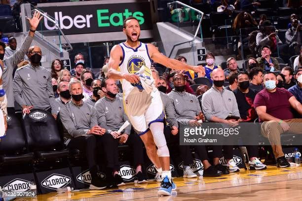 Stephen Curry of the Golden State Warriors celebrates during a preseason game against the Portland Trail Blazers on October 15, 2021 at Chase Center...