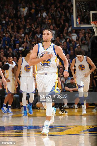 Stephen Curry of the Golden State Warriors celebrates during the game against the New Orleans Pelicans on March 14 2016 at ORACLE Arena in Oakland...