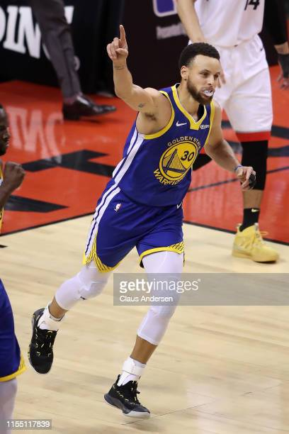 Stephen Curry of the Golden State Warriors celebrates his teams 106105 win over the Toronto Raptors in Game Five of the 2019 NBA Finals at Scotiabank...
