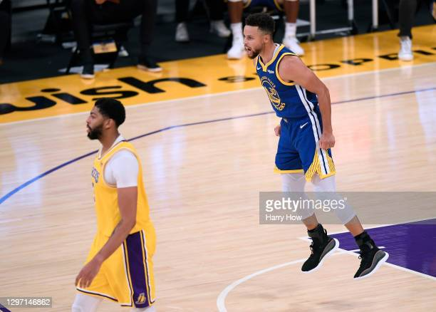 Stephen Curry of the Golden State Warriors celebrates his three pointer behind Anthony Davis of the Los Angeles Lakers, during a 115-113 Warriors win...