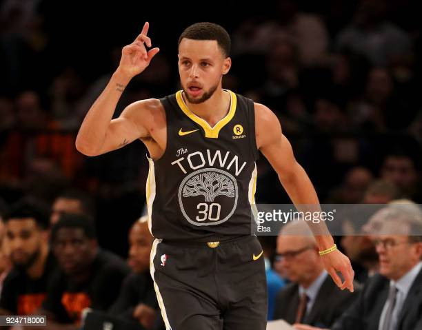 Stephen Curry of the Golden State Warriors celebrates his three point shot in the second half against the New York Knicks at Madison Square Garden on...