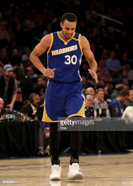 Stephen Curry of the Golden State Warriors celebrates in the fourth quarter against the New York Knicks at Madison Square Garden on March 5 2017 in...