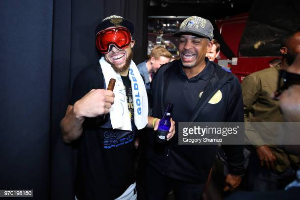 Stephen Curry of the Golden State Warriors celebrates in the locker room with father Dell Curry after defeating the Cleveland Cavaliers during Game...