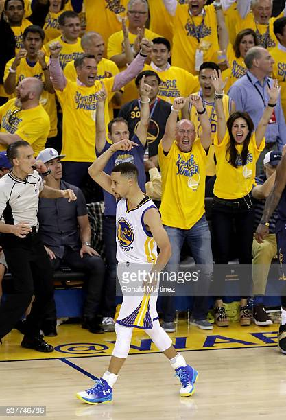 Stephen Curry of the Golden State Warriors celebrates late in the fourth quarter while taking on the Cleveland Cavaliers in Game 1 of the 2016 NBA...