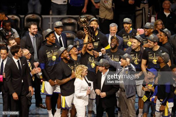 Stephen Curry of the Golden State Warriors celebrates on stage with the Larry O'Brien Championship Trophy after winning Game Four of the 2018 NBA...