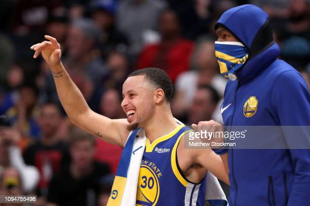 Stephen Curry of the Golden State Warriors celebrates on the bench against the Denver Nuggets in the fourth quarter at the Pepsi Center on January 15...